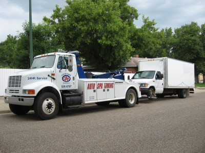Heavy duty towing truck representing Auto Spa Towing Ltd.