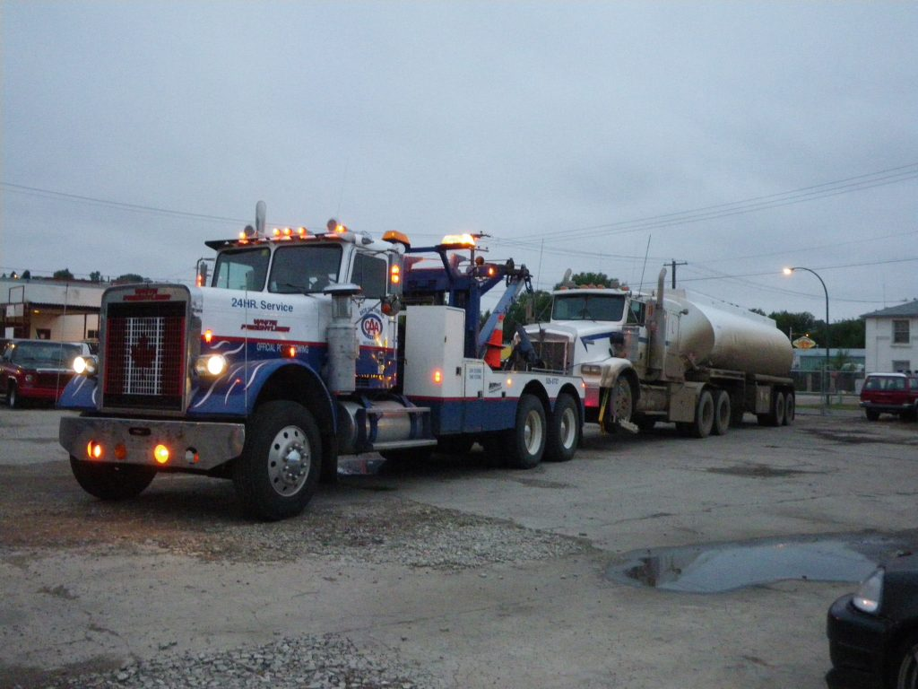 tanker towed by Heavy Duty Tow Truck representing Auto Spa Towing Ltd.