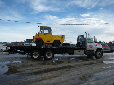 Moving equipment representing Auto Spa Towing Ltd.